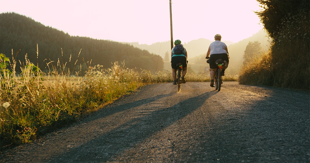 "Kailey and Marley riding off into the sunset in Shimano Originals ""All Bodies on Bikes"""