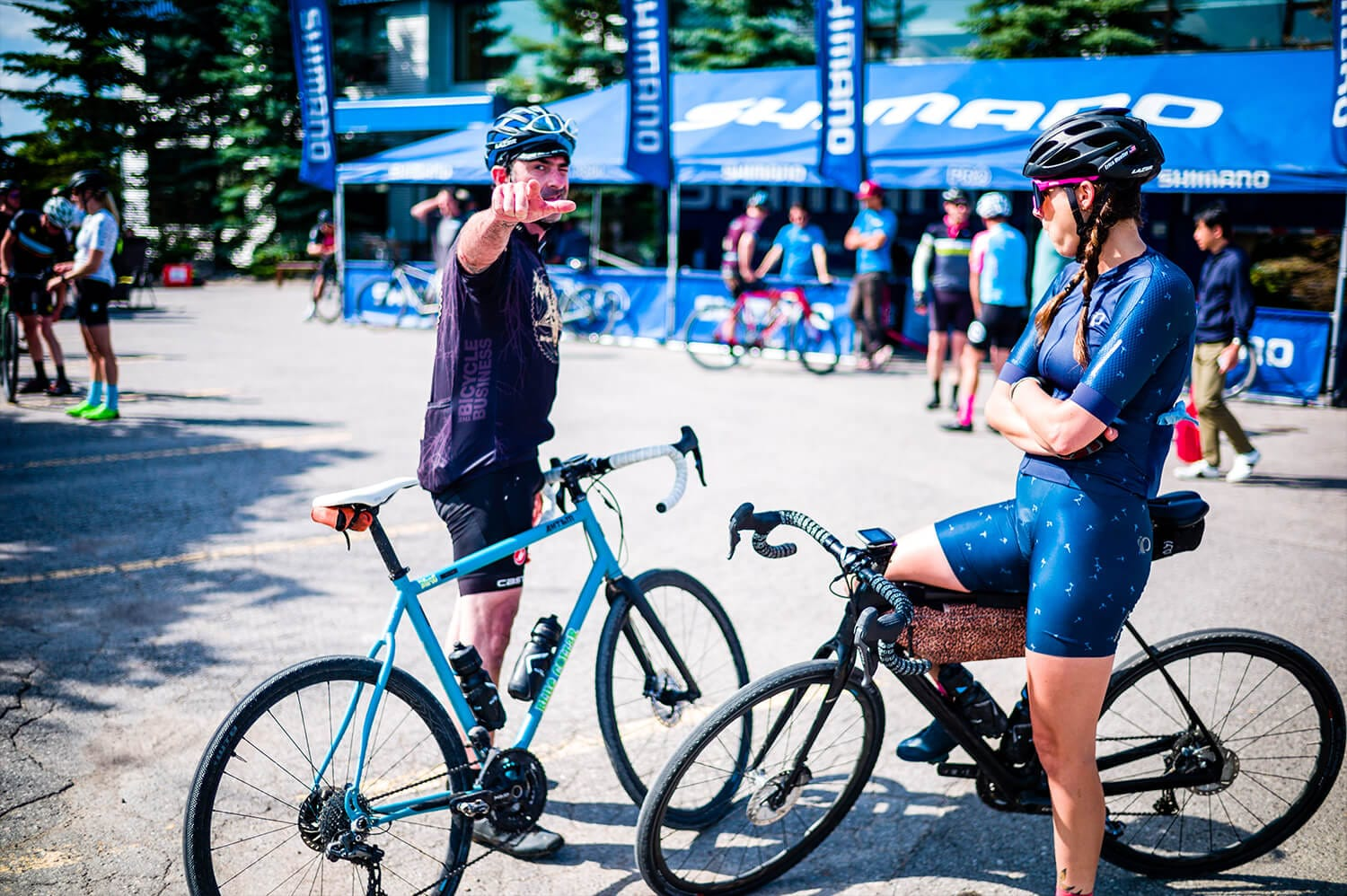 Two cyclist chatting in front of the Shimano bikes gear booth